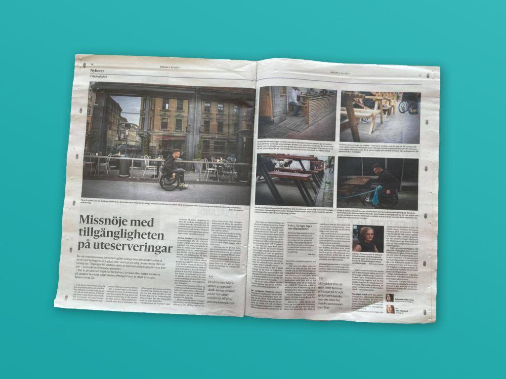 Foto av ett uppslag i Göteborgs-Posten, reportage om otillgänglighet på andra långgatan